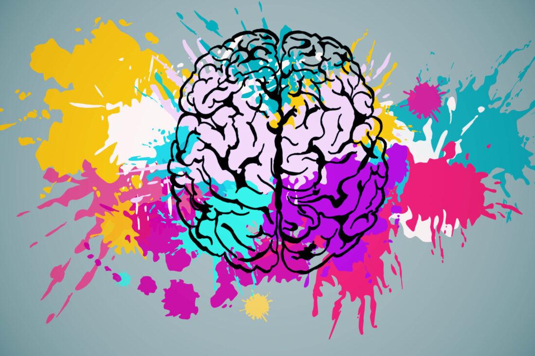 Illustration eines Gehirns. Es ist transparent, so dass die bunten Farbkleckse im Hintergrund und rundherum sichtbar sind.